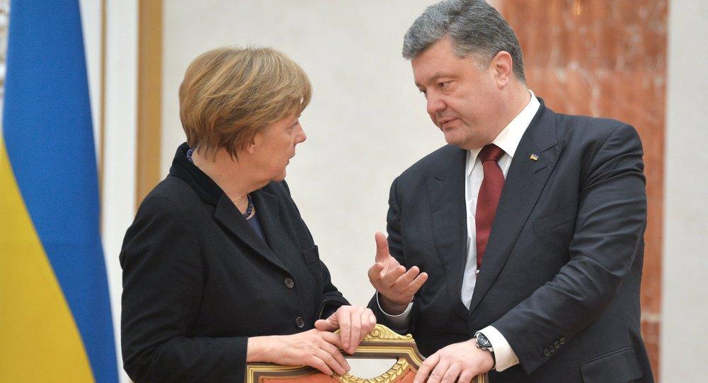 بوروشينكو وميركل