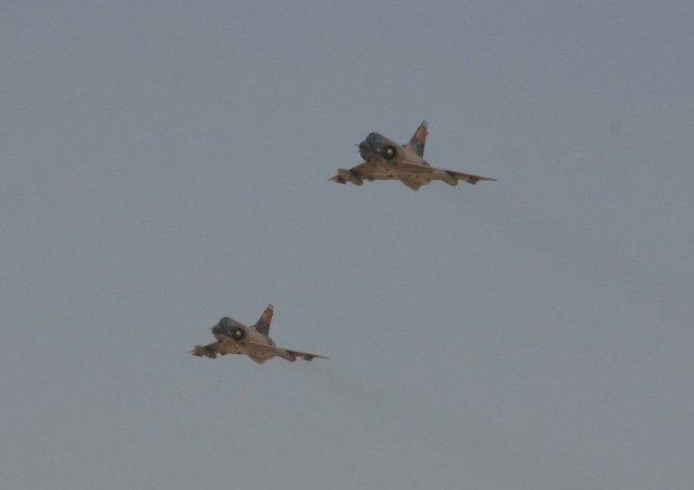 Two Egyptian Air Force Mirage fighter jets execute a bombing run