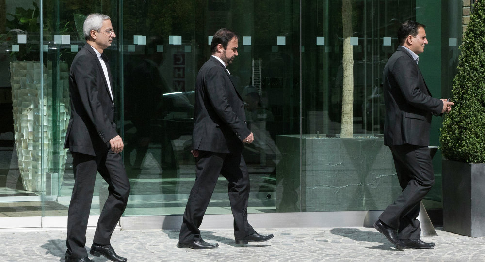 Iran's ambassador to the IAEA (International Atomic Energy Agency), Reza Najafi (C) leaves Coburg Palace during the E3/EU+3 and Iran talks in Vienna on April 22, 2015