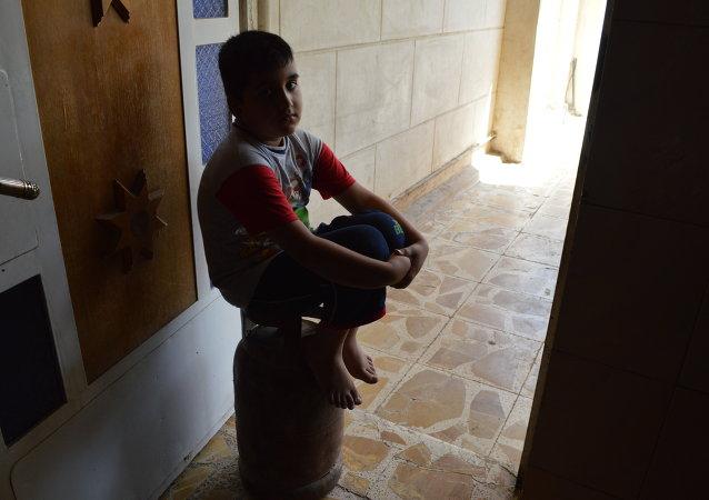 طفل عراقي في حوزة تنظيم داعش لتهيئته ليصبح قنبلة بشرية