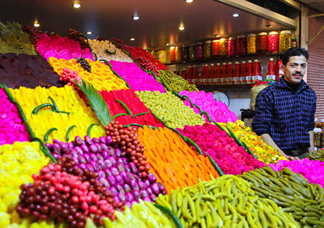 Stand offering various sourts of pickeled and colored vegetables at a covered street market in central Damascus