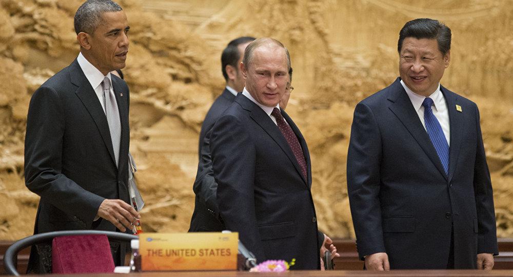 فلاديمير بوتين وباراك أوباما وشي جين بينغ