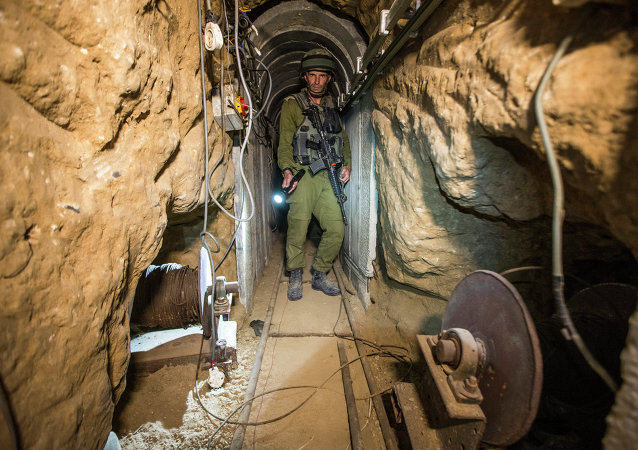 An Israeli army officer gives explanations to journalists on July 25, 2014 during an army-organised tour in a tunnel said to be used by Palestinian militants from the Gaza Strip for cross-border attacks