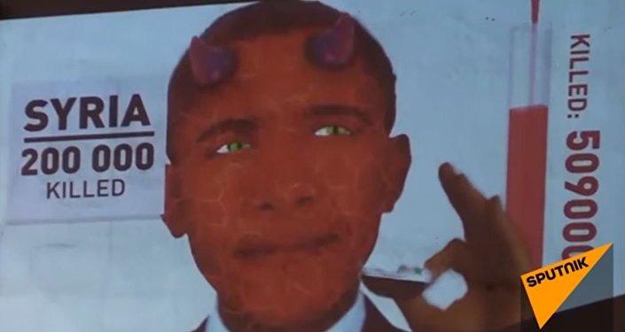أوباما الشيطان يأكل علم سوريا وليبيا والعراق