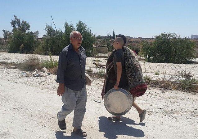 سكان المشروع 1070 في حلب يهربون من بطش المسلحين