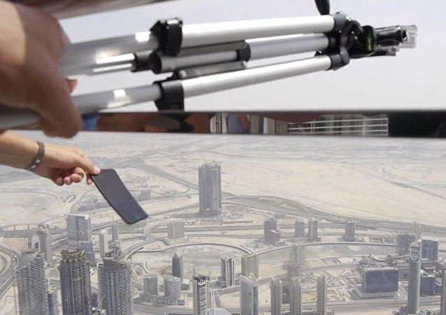 شاهد ماذا يحدث لـ آيفون بلاس 7 إذا رميته من برج خليفة