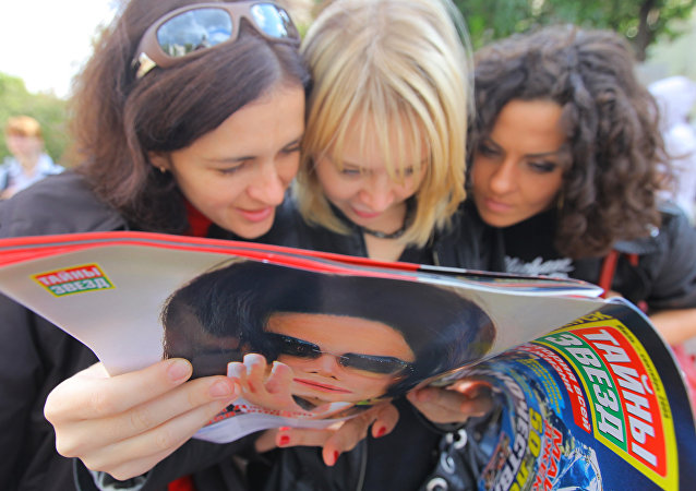 Michael Jackson fans gather at Moscow's Teatralnaya Square to pay tribute to pop icon