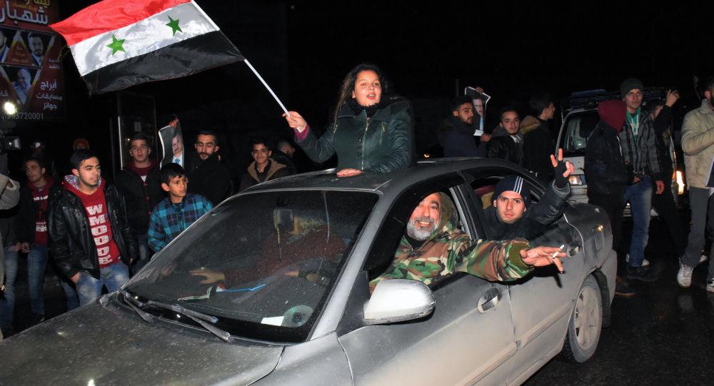 احتفال بتحرير حلب من سيطرة المسلحين
