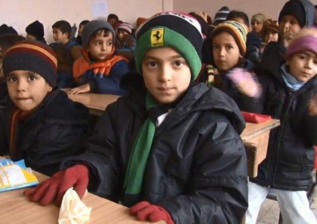 أطفال حلب يعودون إلى المدارس