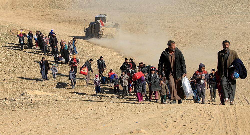 جانب من مواطني الموصل الفارين من جرائم داعش