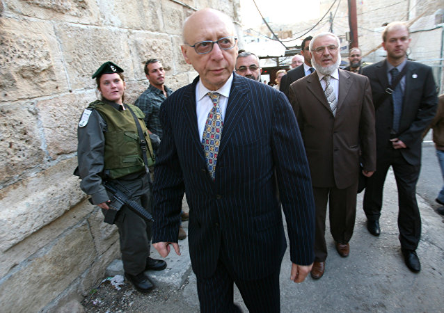 Hamas member Aziz Dweik (2nd-R), of the Palestinian Legislative Council (PLC) walks with Jewish British MP Gerald Kaufman as they walk past Israeli border police guards standing at the entrance of the Abraham Mosque or the Tomb of the Patriarch, a holy site to both Muslims and Jews, in the West Bank town of Hebron, on November 01, 2010.