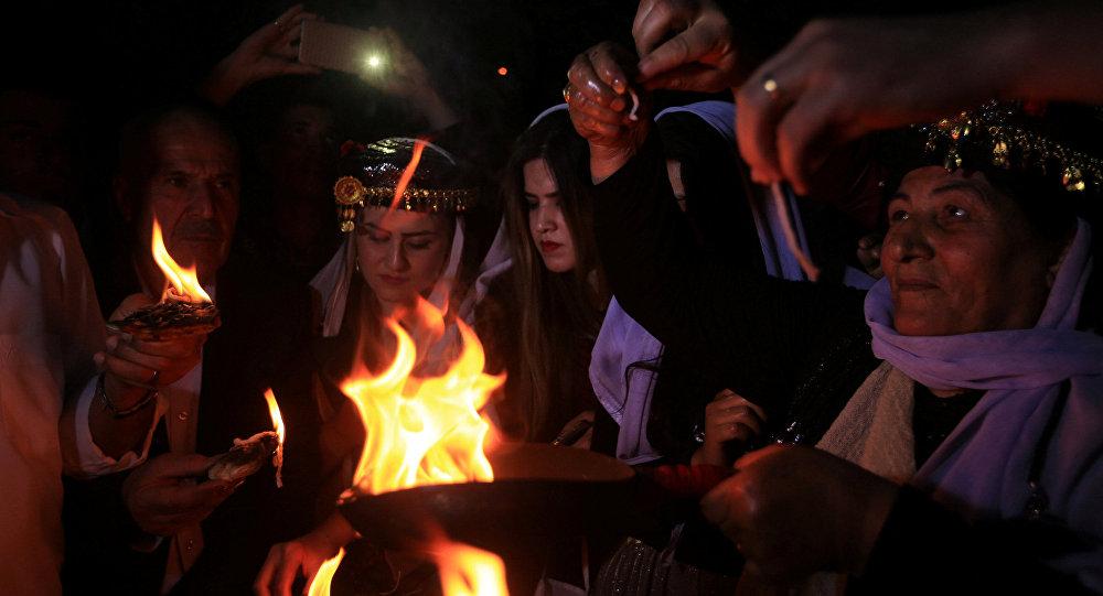 عراقيون إيزيديون خلال حفل الاحتفال بالعام الجديد في معبد لاليش بدهوك