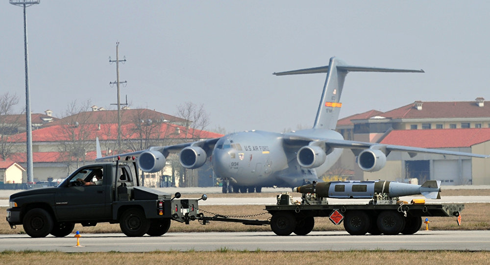Weapons are carried in front of US airforce C17 at the Aviano air base on March 25, 2011.
