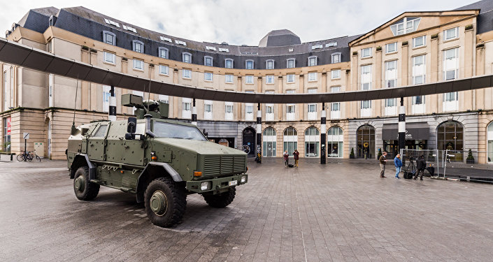 A Belgian Army vehicle is parked on the almost deserted square in front of the main train station in the center of Brussels on Sunday, Nov. 22, 2015.