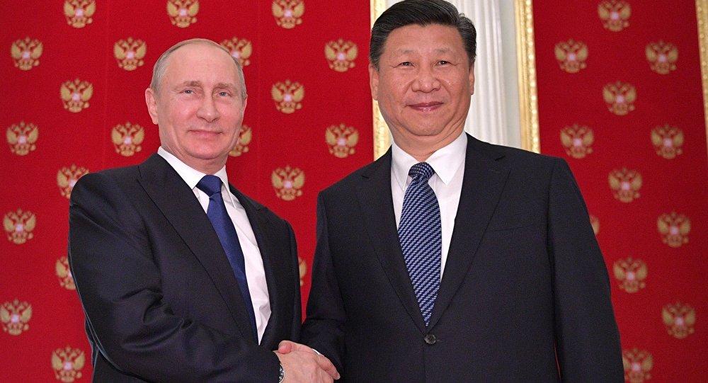 الرئيس الروسي فلاديمير بوتين مع الرئيس الصيني شي جين بينغ