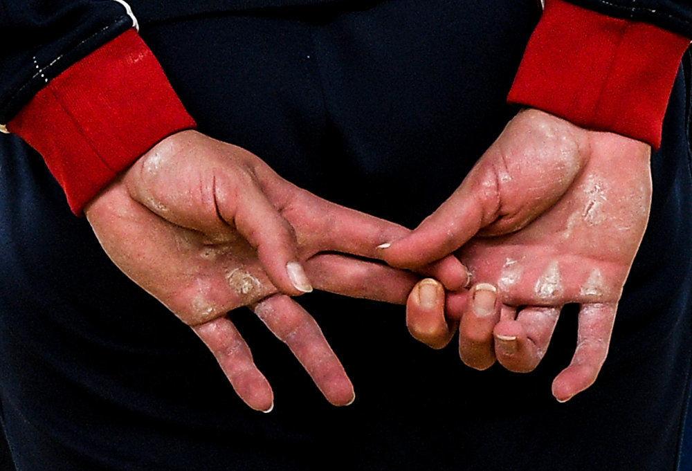 جائزة ستينين للتصوير المحترف في فئة الرياضة - صورة للمصور أليكسي فيليبوف بعنوان على أطراف الأصابع (صورة للرياضية الروسية ماريا باسيكا خلال الألعاب الأولمبية  الصيفية)