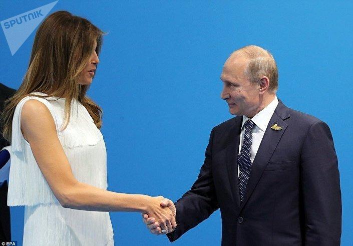 الرئيس بوتين يصافح ميلانيا ترامب