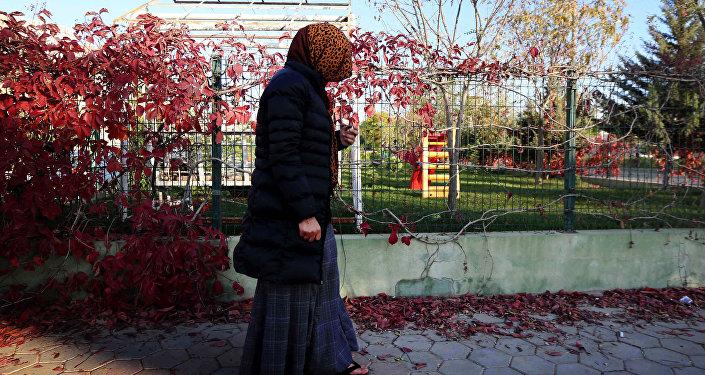 امرأة وقعت تحت سيطرة داعش