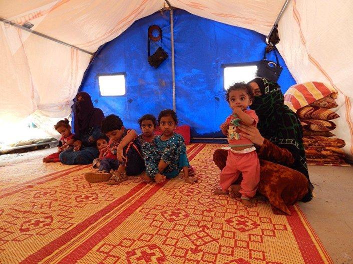 """عوائل """"الدواعش"""" من وهم الخلافة إلى خيام الإيواء في صحراء الموصل 1025281985"""