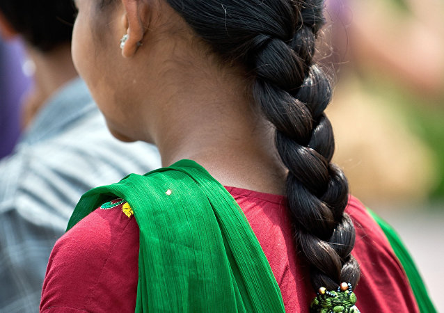 A Indian girl with a traditional hair style walks in New Delhi. (File)
