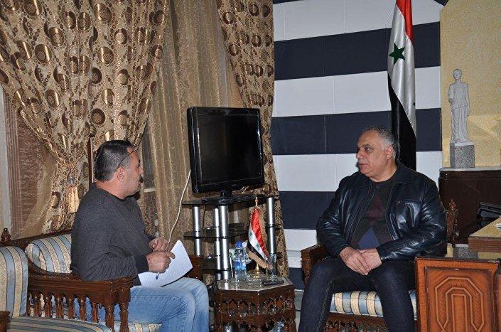 محافظ حمص ومراسل سبوتنيك