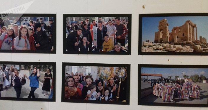 توثيق روسي لمعاناة الشعب السوري بمعرض سوريا التي ستنتصر