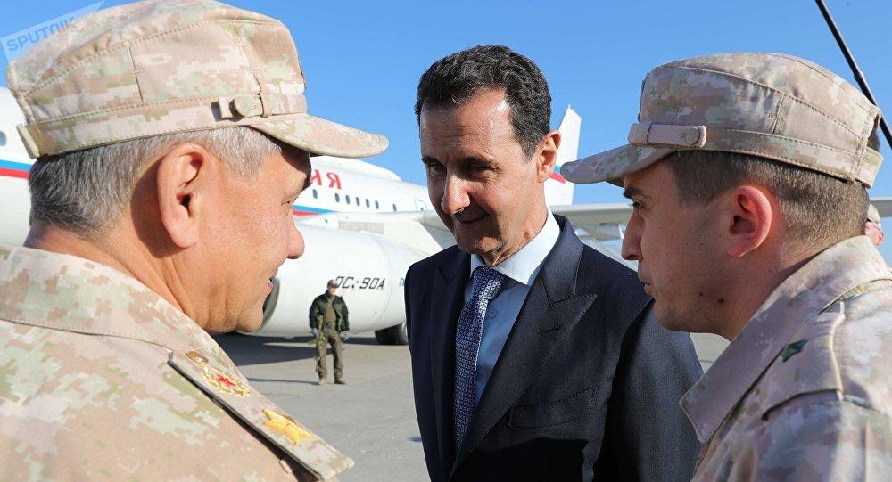 الرئيس السوري بشار الأسد يستقبل الرئيس فلاديمير بوتين في القاعدة حميميم، سوريا 11 ديسمبر/ كانون الأول 2017