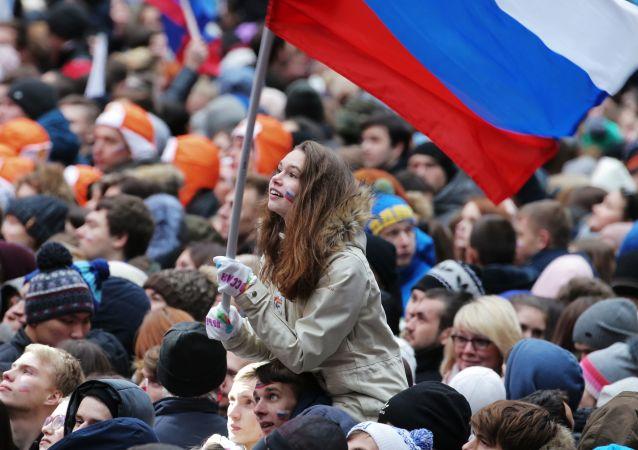 جمهور حفل روسيا توحد! في الملعب لوجنيكي في موسكو
