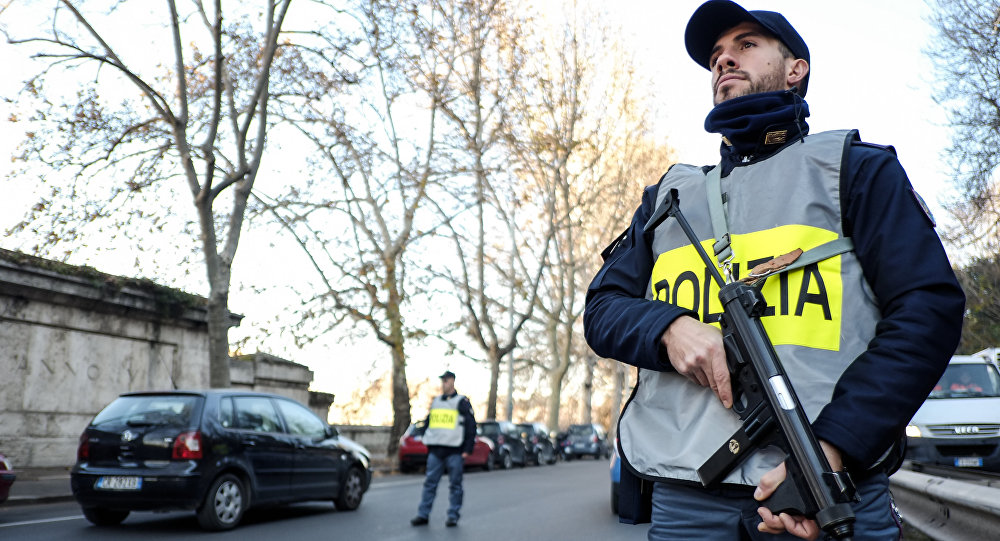 Italian police officers stand guard at a security check-point in a central street of Rome