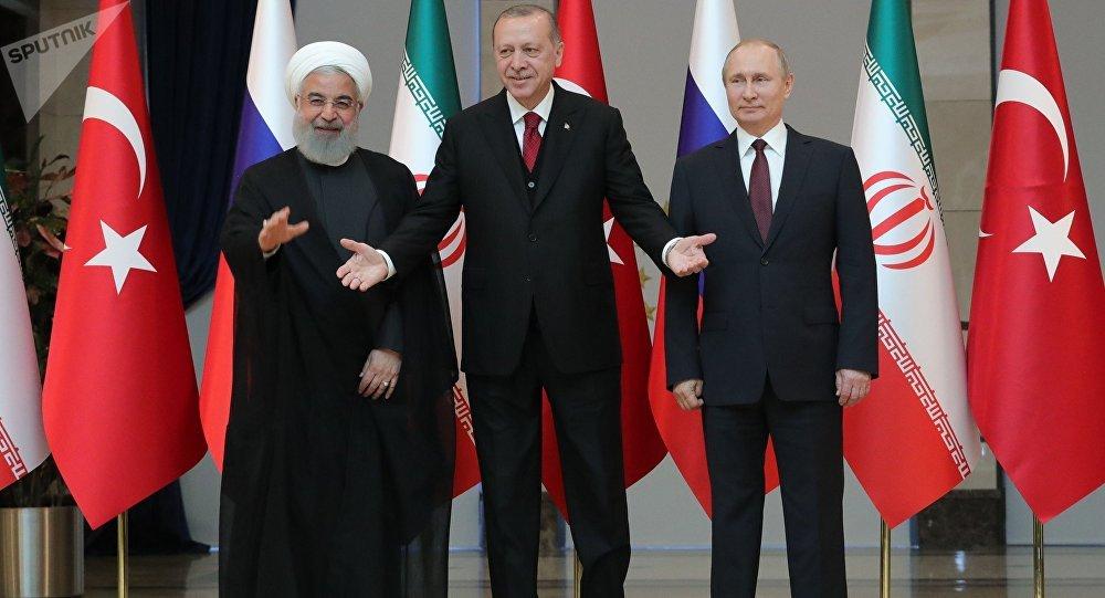 القمة الثلاثة - روسيا و تركيا و إيران - الرئيس فلاديمير بوتين والرئيس رجب طيب أردوغان والرئيس لاإيراني حسن روحاني في أنقرة، تركيا 4 أبريل/ نيسان 2018
