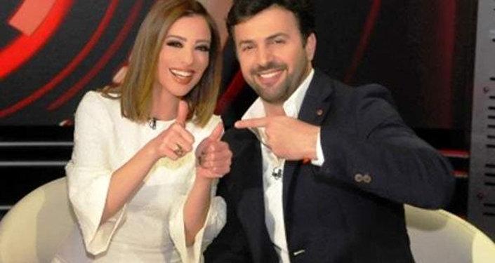 الممثل السوري تيم حسين وزوجته الإعلامية المصرية وفاء الكيلاني