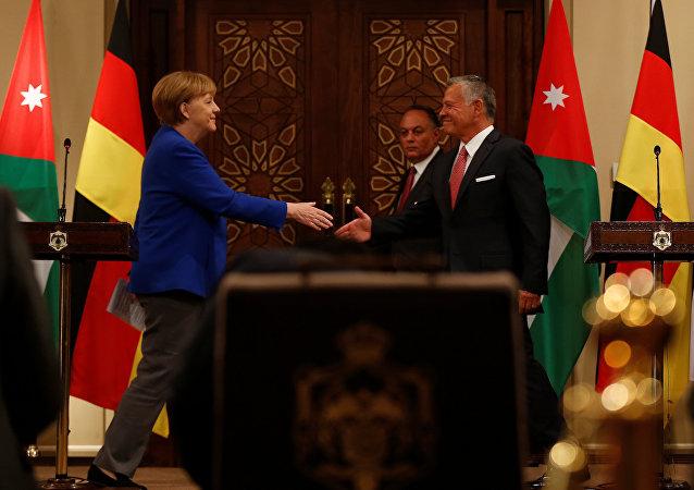 العاهل الأردني الملك عبد الله الثاني والمستشارة الألمانية أنجيلا ميركل