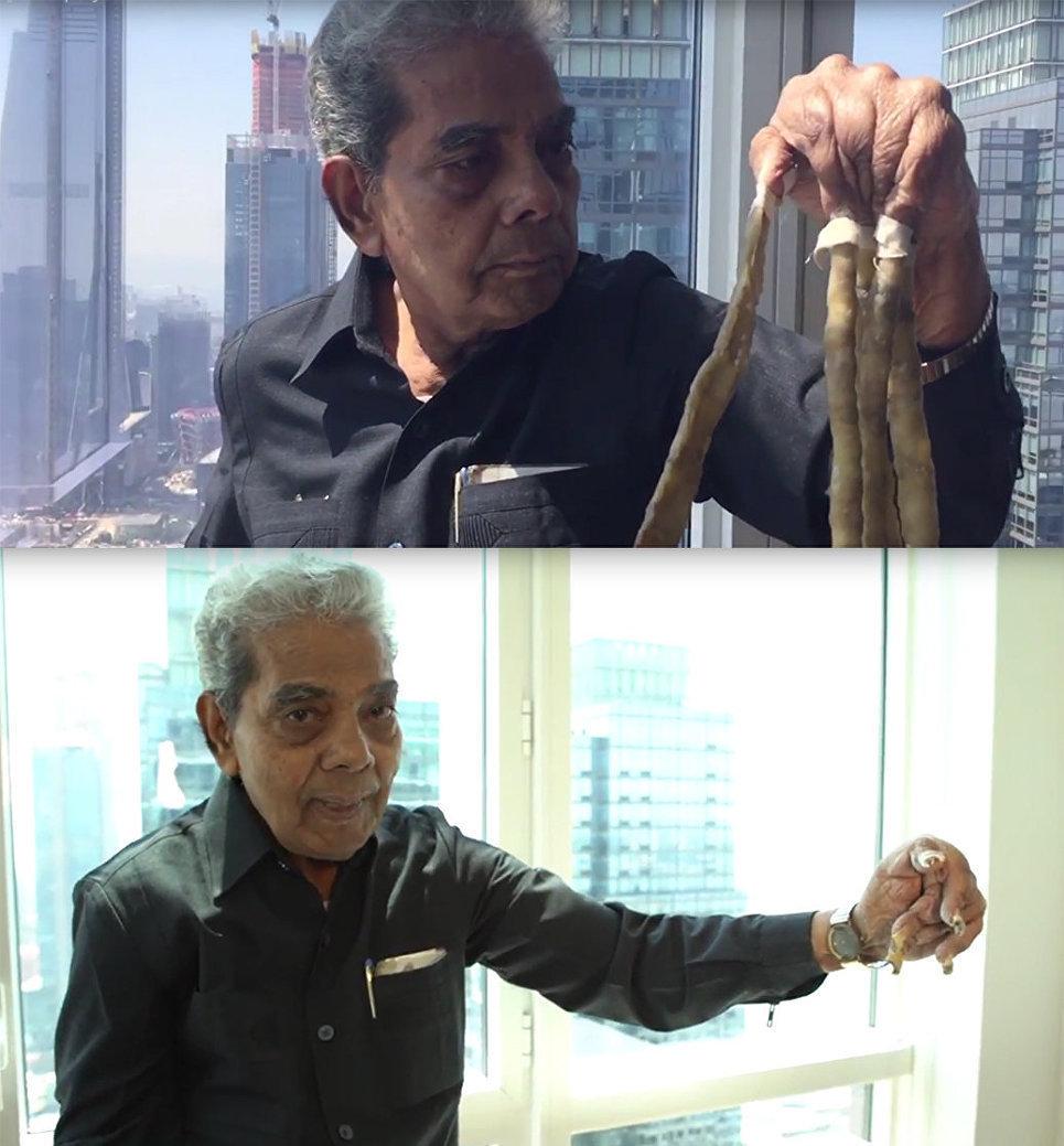 هندي يقص أظافرة بعد 66 سنة من تربيتها