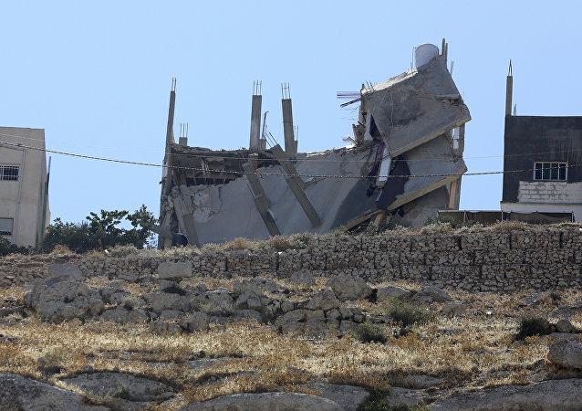 مبنى مهدم في الأردن، بعد العملية الأمنية، السبت 11 أغسطس/آب 2018