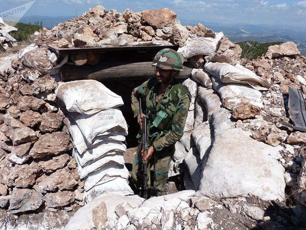 التركستاني يعزز تحصيناته بريف اللاذقية... ويجازف بخروق مستمرة لتوتير الجبهة