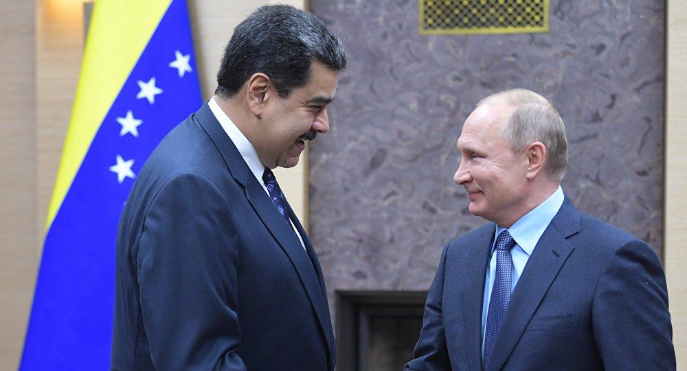 الرئيس الروسي فلاديمير بوتين ونظيره الفنزويلي نيكولاس مادورو