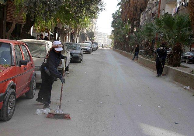 عاملات نظافة في شوارع دمشق