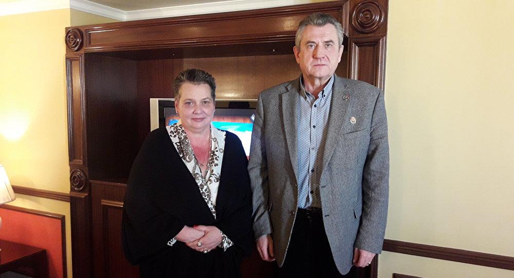سيرغي رونوف رئيس اتحاد المحاربين الروس القدامى والممثلة الخاصة للمنظمة الدولية الإسلامية للأعمال في سورية كرستينا ماريا ليندرستوم