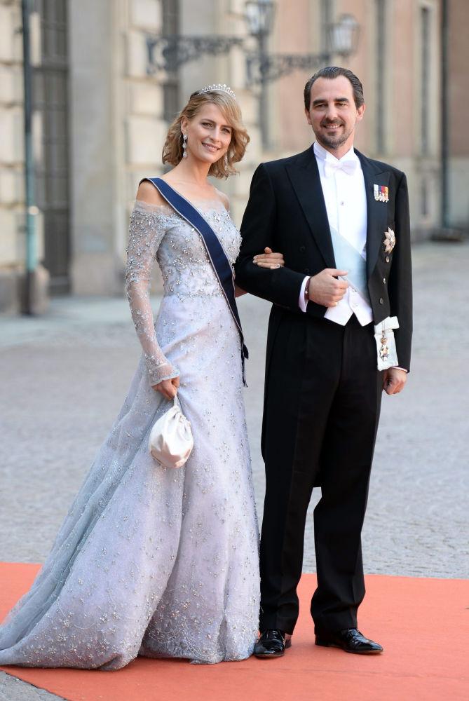 الأميرة تاتيانا، أميرة اليونان، والأمير نيكولاس، أمير اليونان، يحضران حفل زفاف أمير السويد كارل فيليب وضوفيا هيلكفيست في القلعة الملكية في قصر ستوكهولم، 13 يونيو/ حزيران 2015