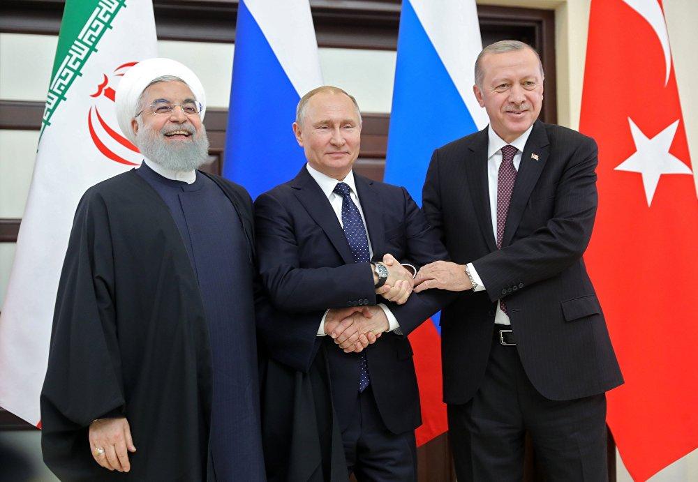 الرئيس الروسي فلاديمير بوتين ونظيره التركي رجب طيب أردوغان والإيراني حسن روحاني في لقاء سوتشي، روسيا 14 فبراير/ شباط 2019