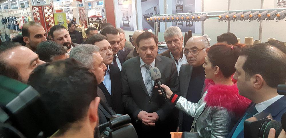مشاركة خليجية بـصنع في سوريا ووزير المالية لـسبوتنيك: افتتاح معبر العراق آت