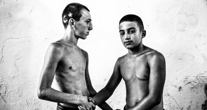 الصورة بعنوان مهرجان كيركبينار للمصارعة بالزيت، فئة الرياضة، للمصور إليف أوزتيورك أوزغونكو من تركيا