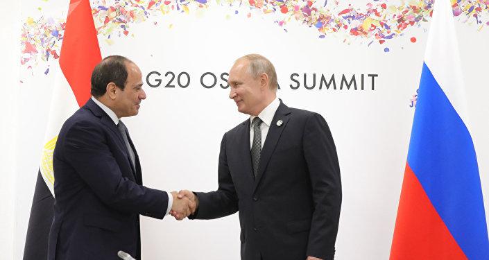 فلاديمير بوتين وعبد الفتاح السيسي في قمة العشرين باليابان