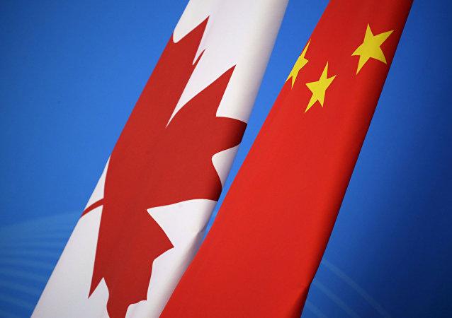 علم كندا و الصين
