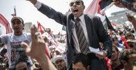 معارضو الرئيس محمد مرسي في ميدان التحرير، عام 2013