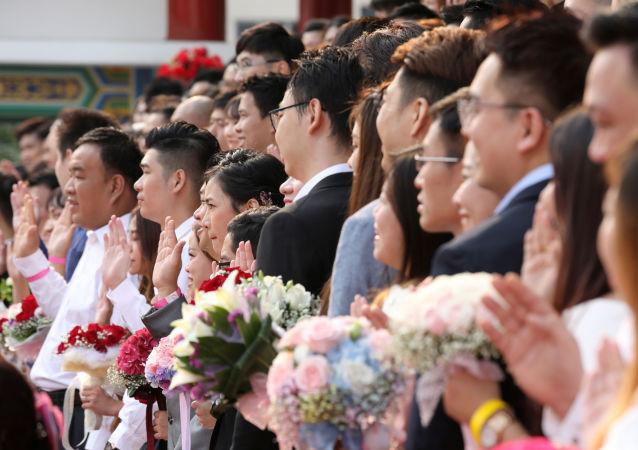 المشاركون في عرس جماعي في كوالا لمبور، ماليزيا 9 سبتمبر/ أيلول 2019