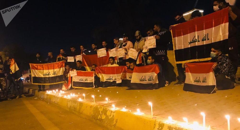 وقفة تضامنية مع الشهداء الذين سقطوا في الاحتجاجات العراقية، شارع الزهور وسط مدينة تكريت، العراق ديسمبر 2019