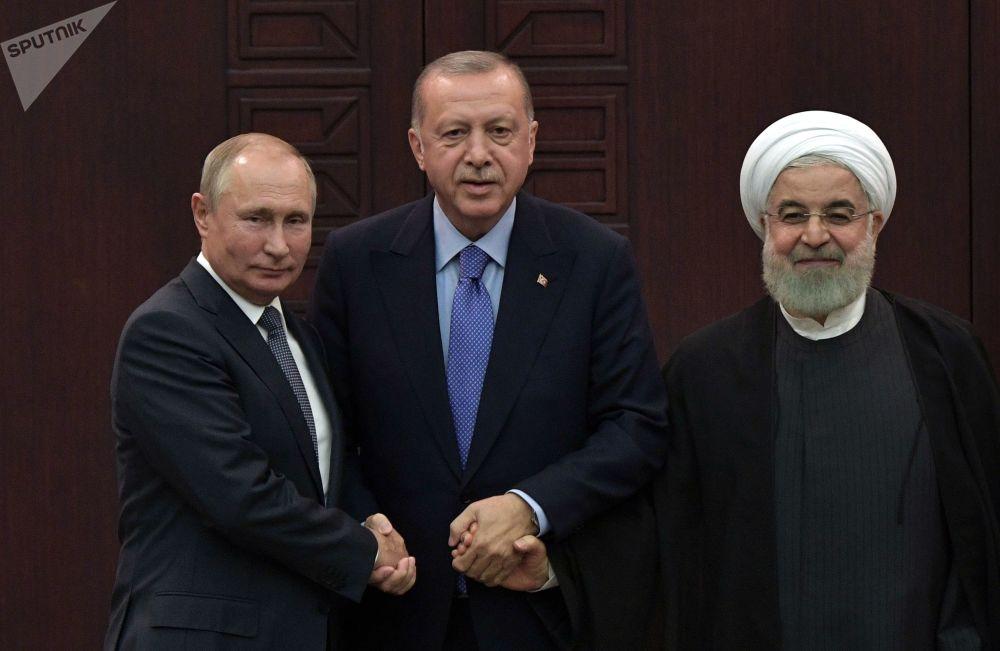 القمة الثلاية - اجتماع القادة: الرئيس الروسي فلاديمير بوتين والرئيس الإيراني حسن روحاني والرئيس التركي رجب طيب أردوغان في أنقرة، 16 سبتمبر 2019