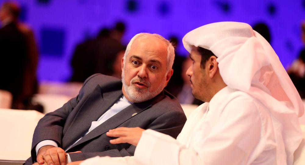 وزير الخارجية القطري محمد بن عبد الرحمن آل ثاني ووزير الخارجية الإيراني محمد جواد ظريف