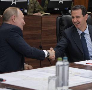 الرئيس الروسي  فلاديمير بوتين والرئيس السوري بشار الأسد خلال اللقاء في مقر قيادة القوات المسلحة الروسية، سوريا 7 يناير 2020
